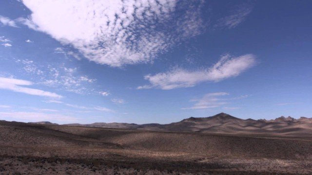 Time-lapse desert landscape – night and day
