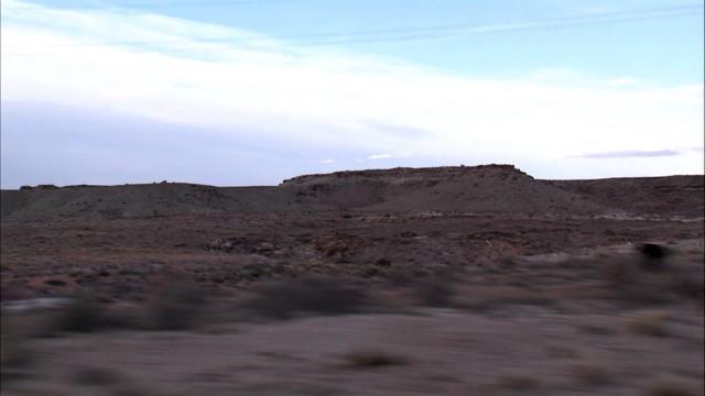 Desert landscape seen from a moving car.