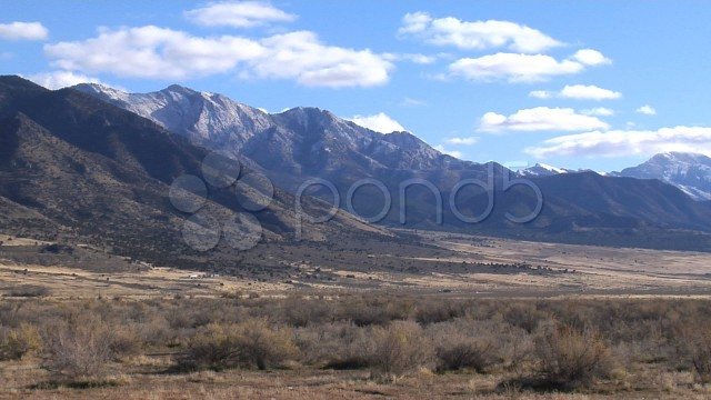 Clouds And Mountains Tower Over A Barren Desert Landscape Skull Valley Timelapse. Stock Footage