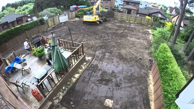 13 tonne excavator doing some garden landscaping