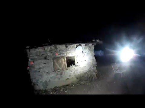 Dirtbike ride through the dark desert landscape at night