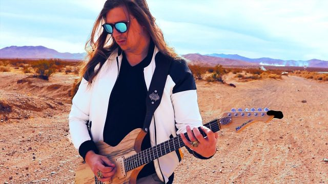 Playing Guitar in Arizona Desert (theme of the rebels)