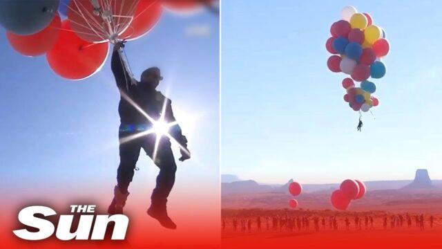 David Blaine soars 20,000ft above desert holding 52 balloons