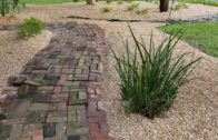 Customized front yard landscape design with river rocks and perennials-after