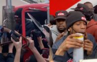 Travis Scott is mobbed by fans when he delivers a